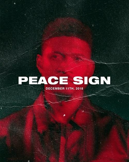 Usher Peace Sign